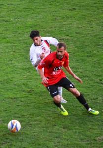 Il centrocampista del Città di Messina Buscema in azione  (foto Omar Menolascina)